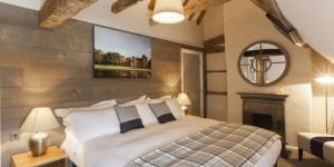 Hotel room with wooden beams