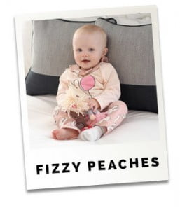 Fizzy Peaches daughter sitting on bed