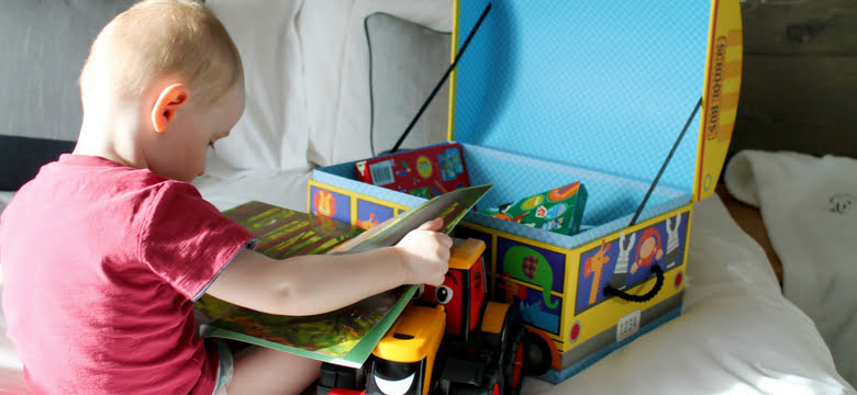 toddler with toy box