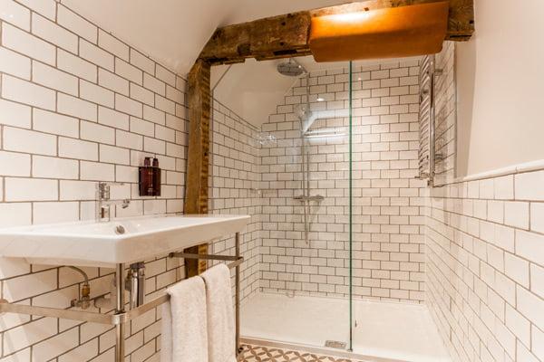 ensuite bathroom with beams